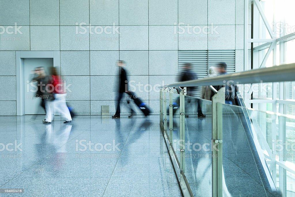 Passengers Walking at Airport, Blurred Motion royalty-free stock photo