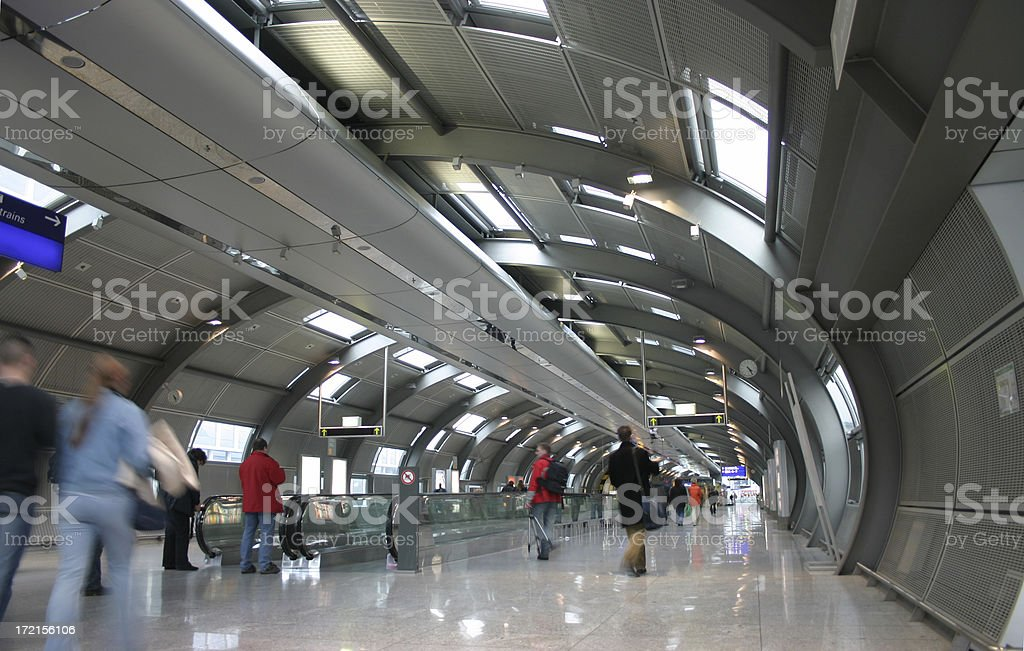 Passengers walking by at the airport royalty-free stock photo