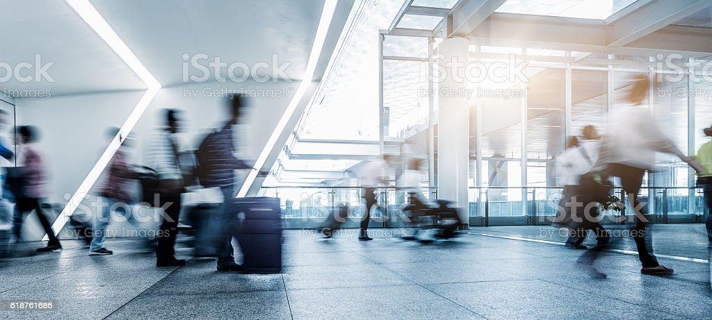 passengers walking in airport interior,shanghai. stock photo