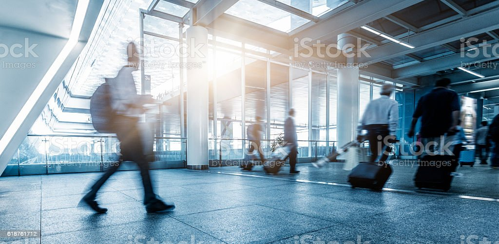 passengers walking in airport interior,shanghai. stock photo