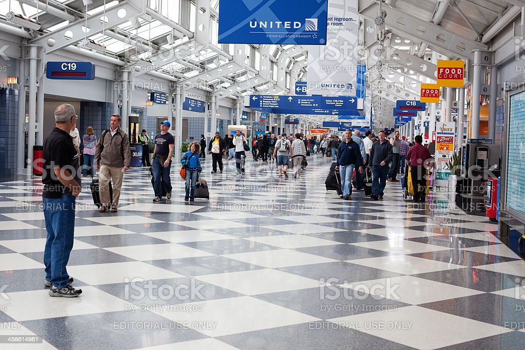 Passengers walking through Chicago O'Hare International Airport royalty-free stock photo