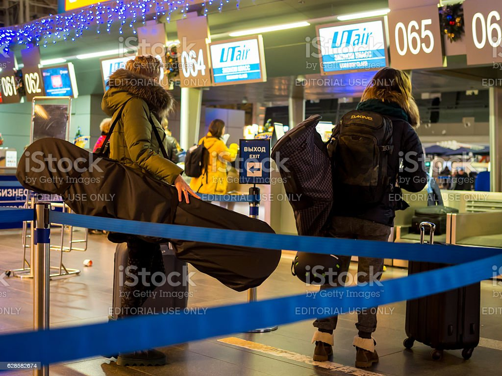 Passengers with inventory for the winter sports awaiting registration stock photo