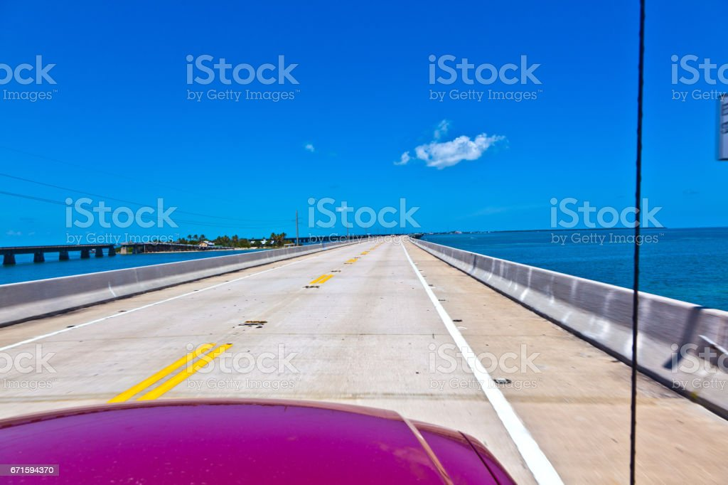 passing a bridge at the ocean stock photo