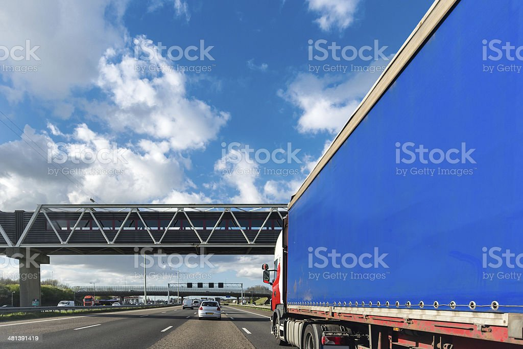 Passing a large blue truck on the freeway royalty-free stock photo