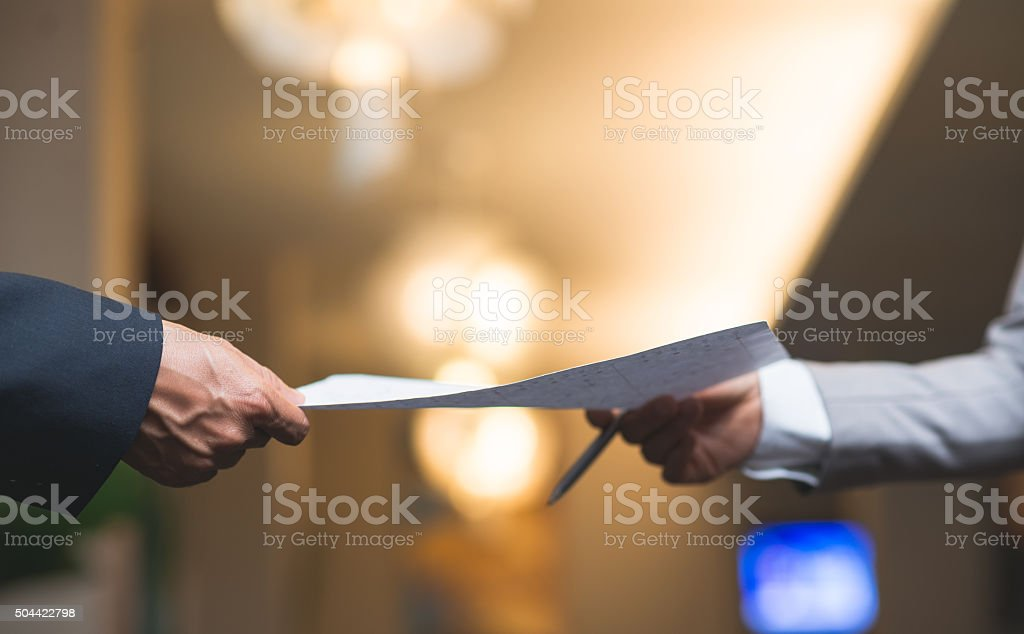 Passing business document stock photo