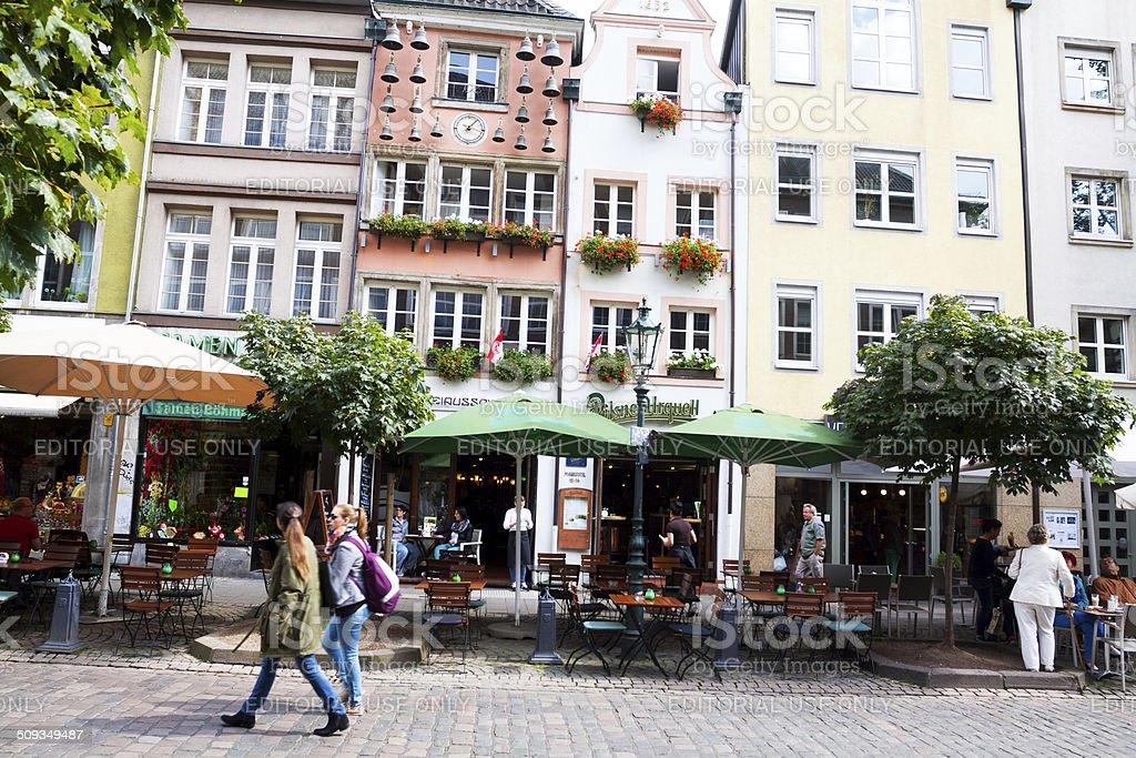 Passing cafes in Altstadt of D?sseldorf stock photo