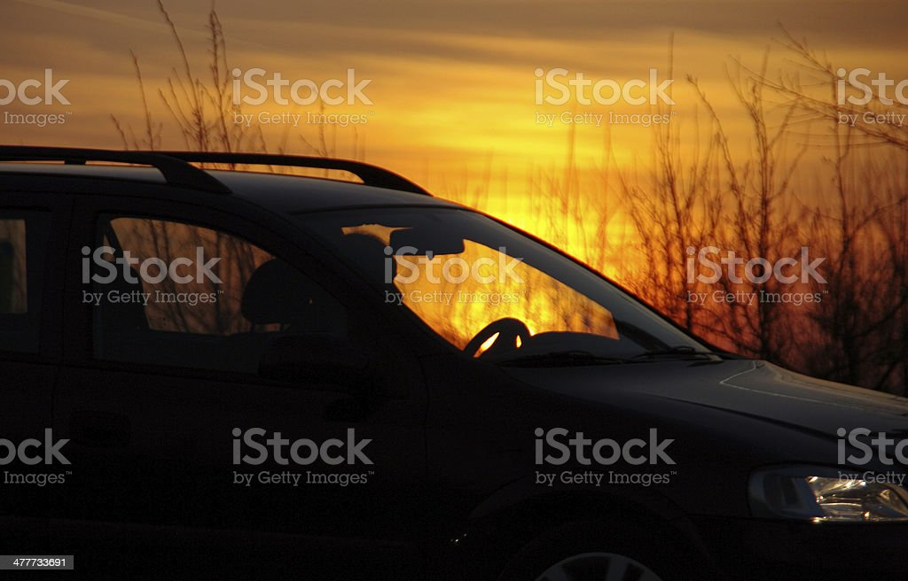 Passing car a sunrise royalty-free stock photo