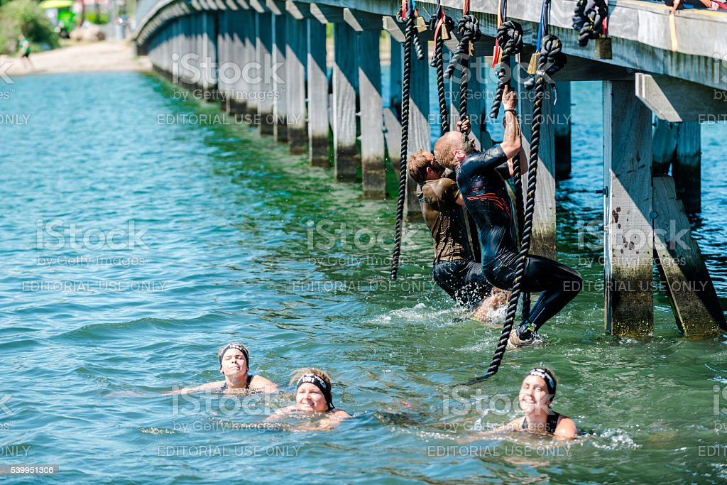 Passing obstacle course race at bridge with ropes stock photo