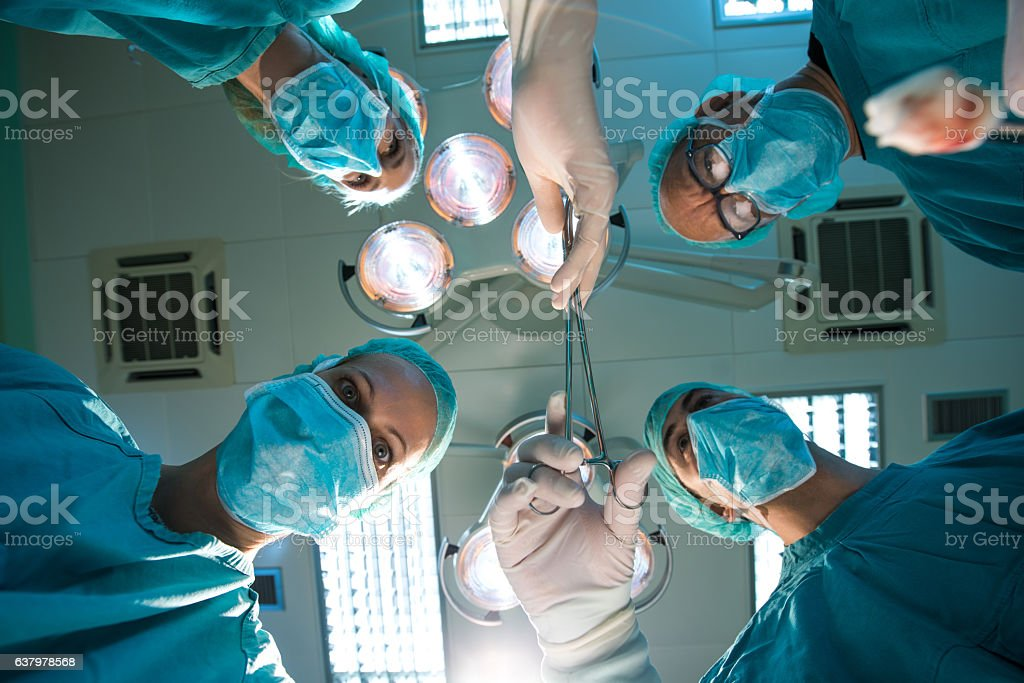 Passing on surgical scissors! stock photo
