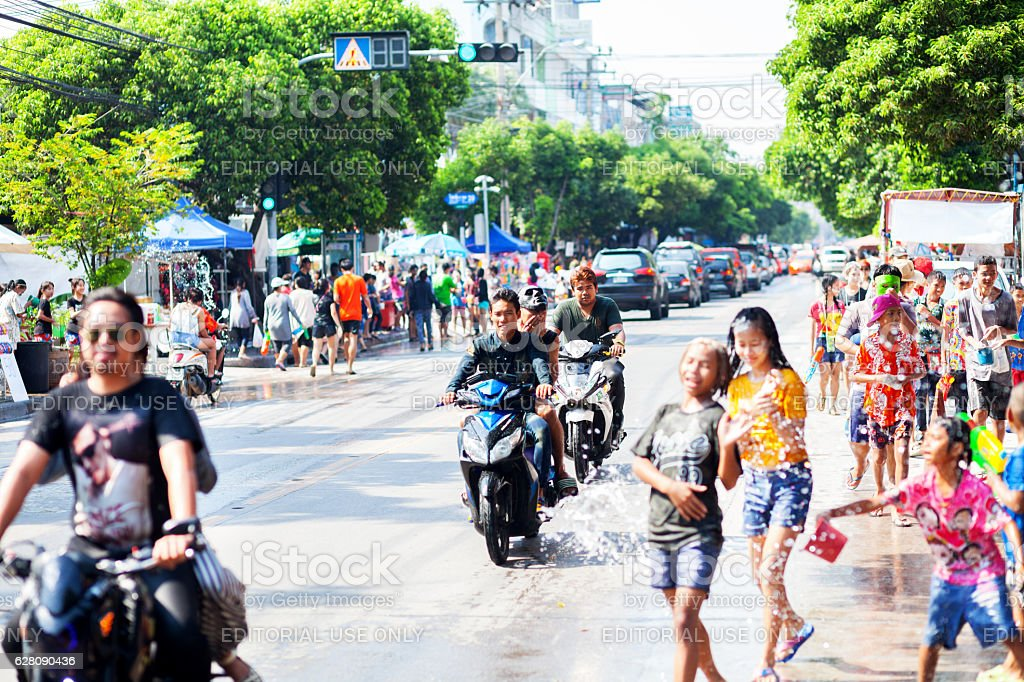 Passing street on motorcycle at Songkran festival stock photo