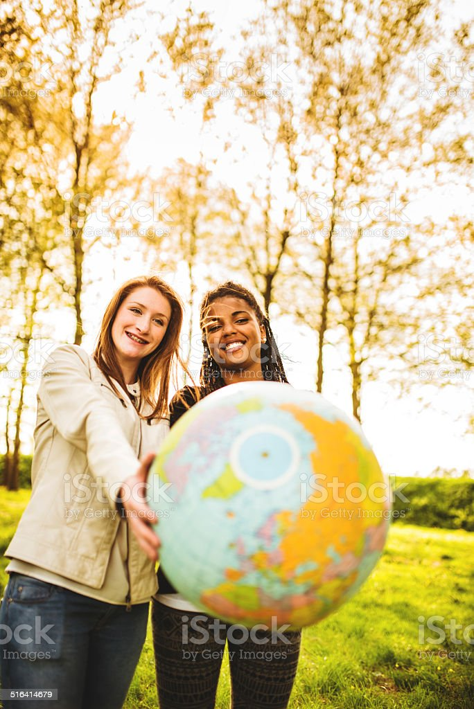 passing the globe for friendship stock photo