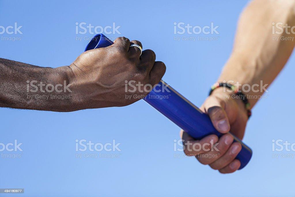 Passing the Relay Baton stock photo