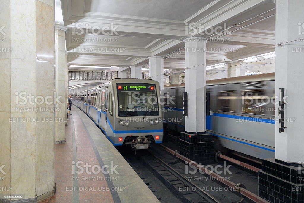 Passing trains at the station 'Alexandrovsky Garden' Moscow Metro stock photo