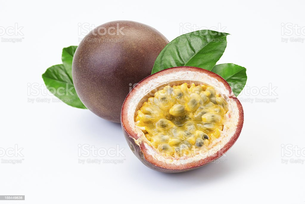 Passion fruit and a half isolated on white background stock photo