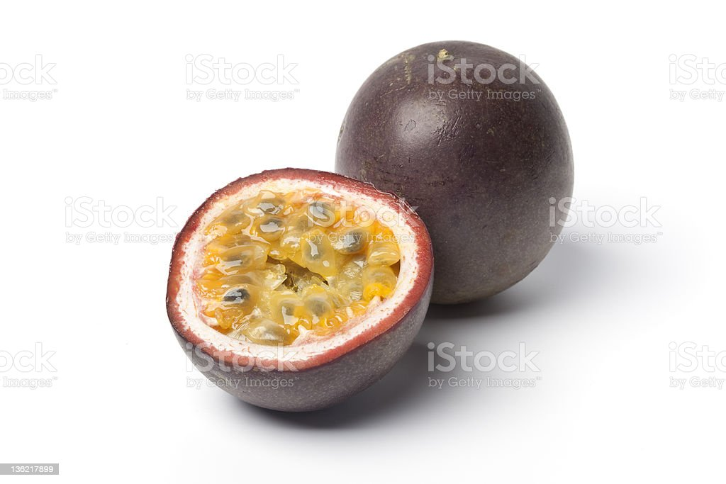 Passion fruit halved in white background stock photo