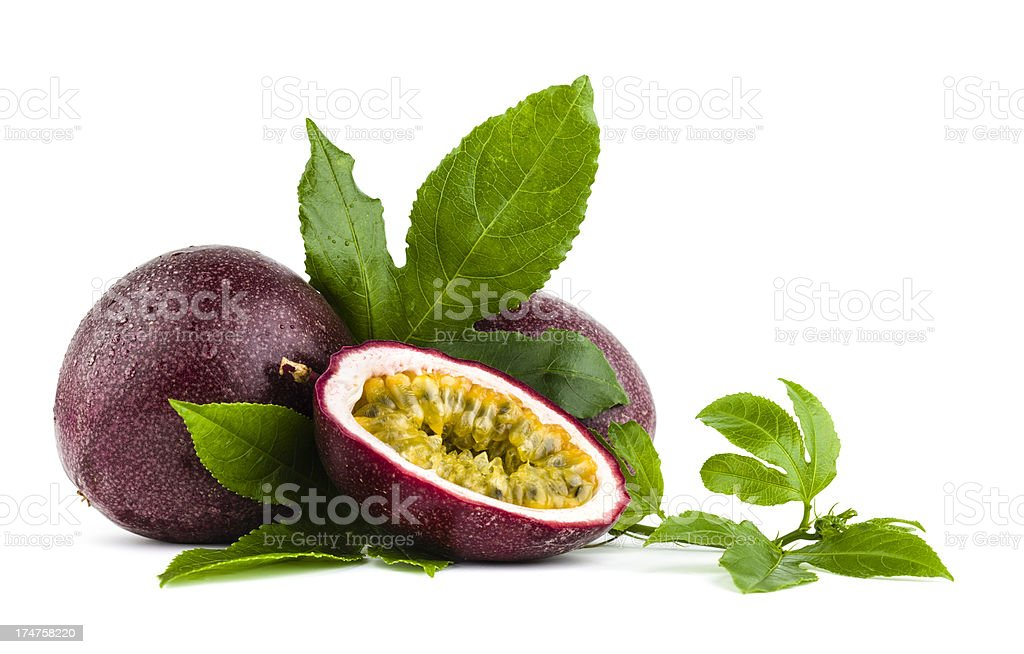 Passion fruits with leaves laying on a white background stock photo