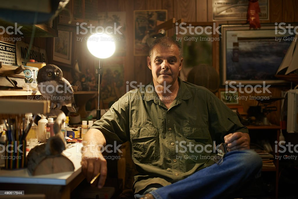 Passionate about woodcarving stock photo