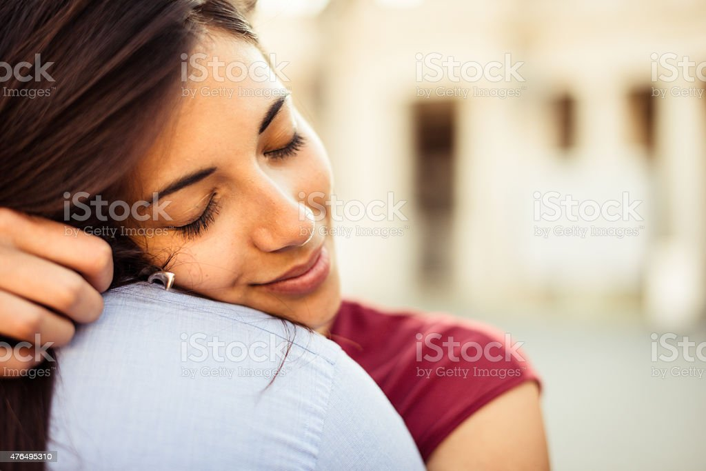 passionate couple embracing at sunset stock photo