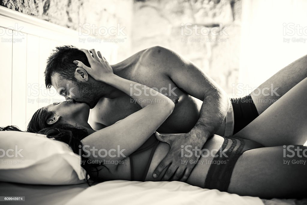 Passionate Couple in the bed stock photo
