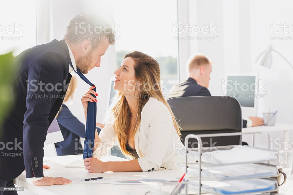 Passionate couple in the office stock photo