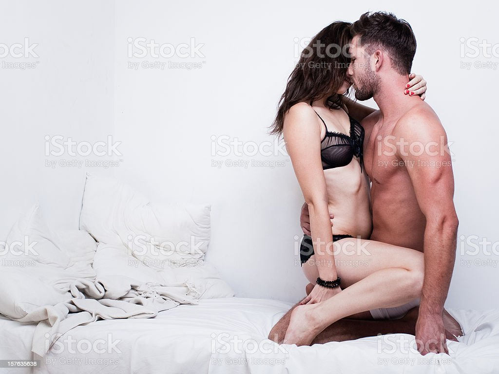 Passionate Couple on the Bed royalty-free stock photo