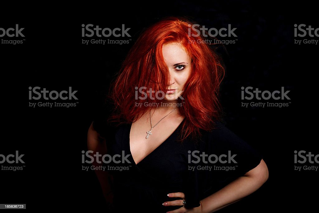 passionate girl with red hair looks directly at you royalty-free stock photo