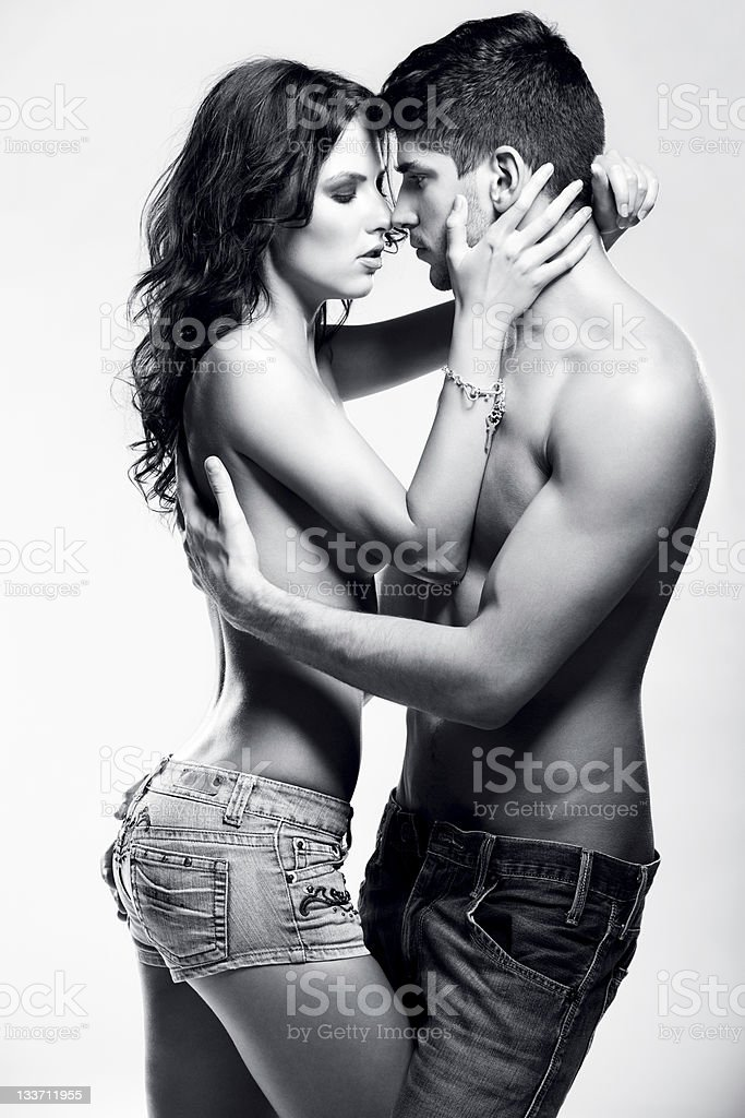 Passionate heterosexual couple in black and white royalty-free stock photo