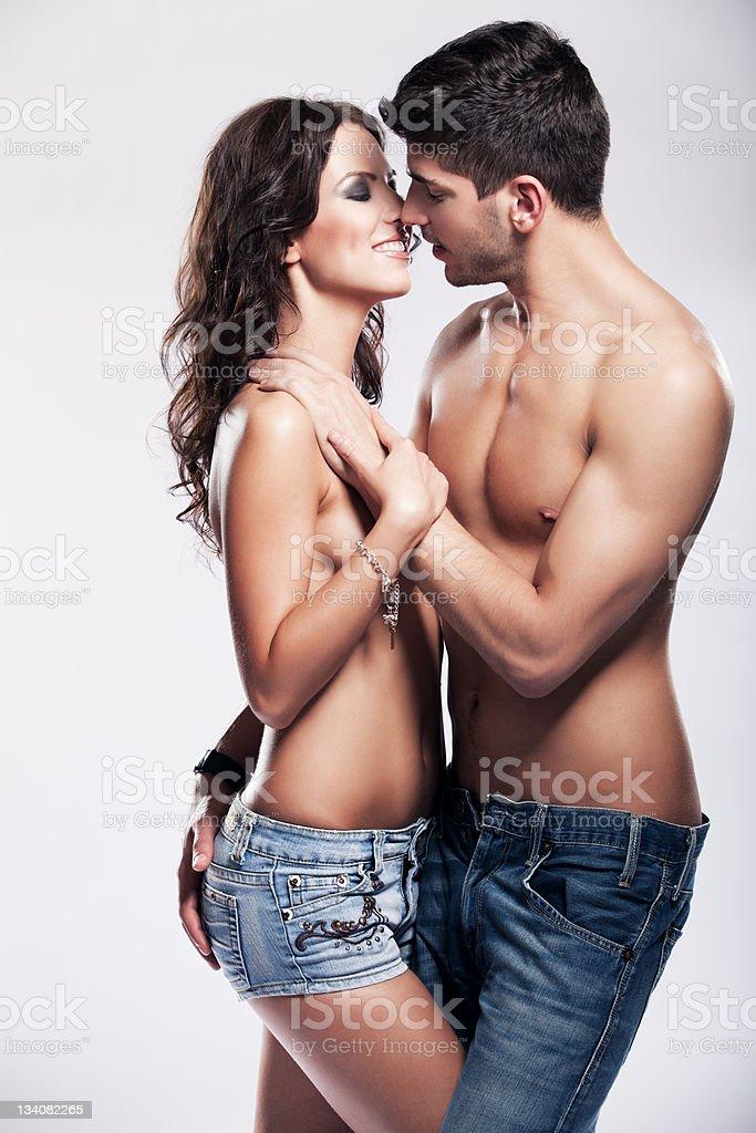 Passionate heterosexual couple in studio royalty-free stock photo