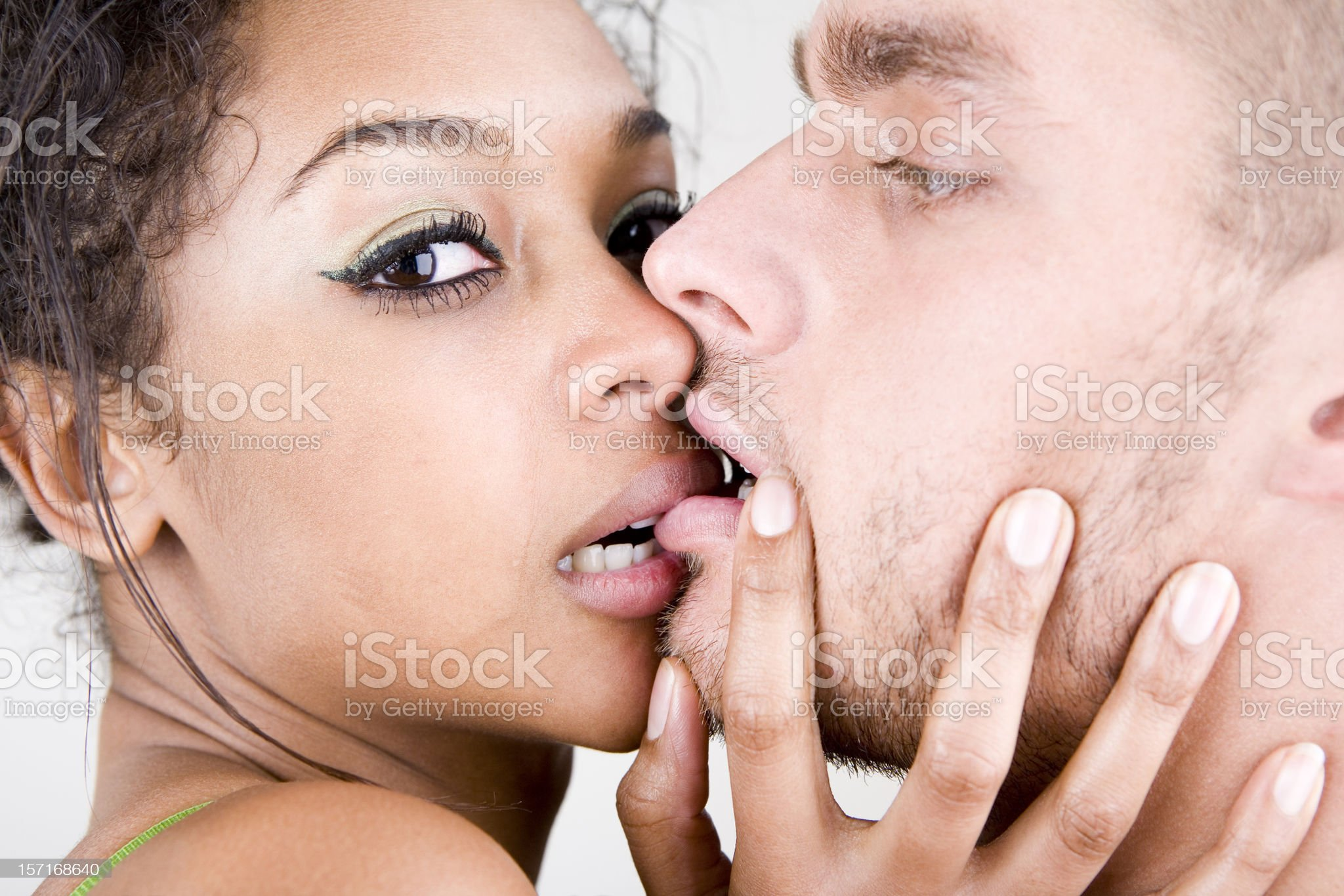 Passionate kiss between a pair of young lovers royalty-free stock photo
