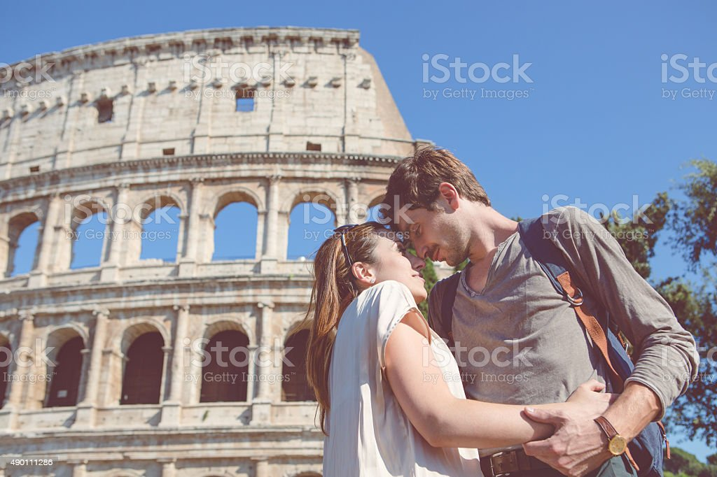 Passionate kiss in front of the Coliseum stock photo