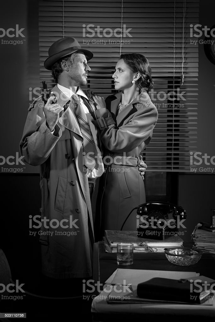 Passionate vintage couple with gun stock photo