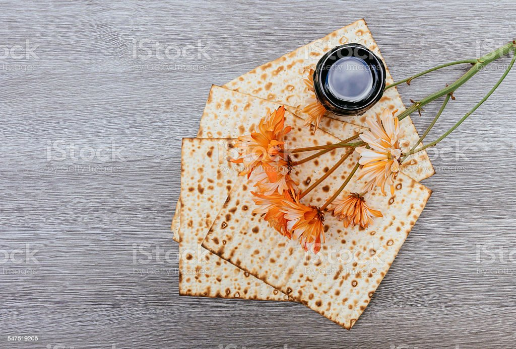passover background. wine and matzoh over wooden table. process. stock photo