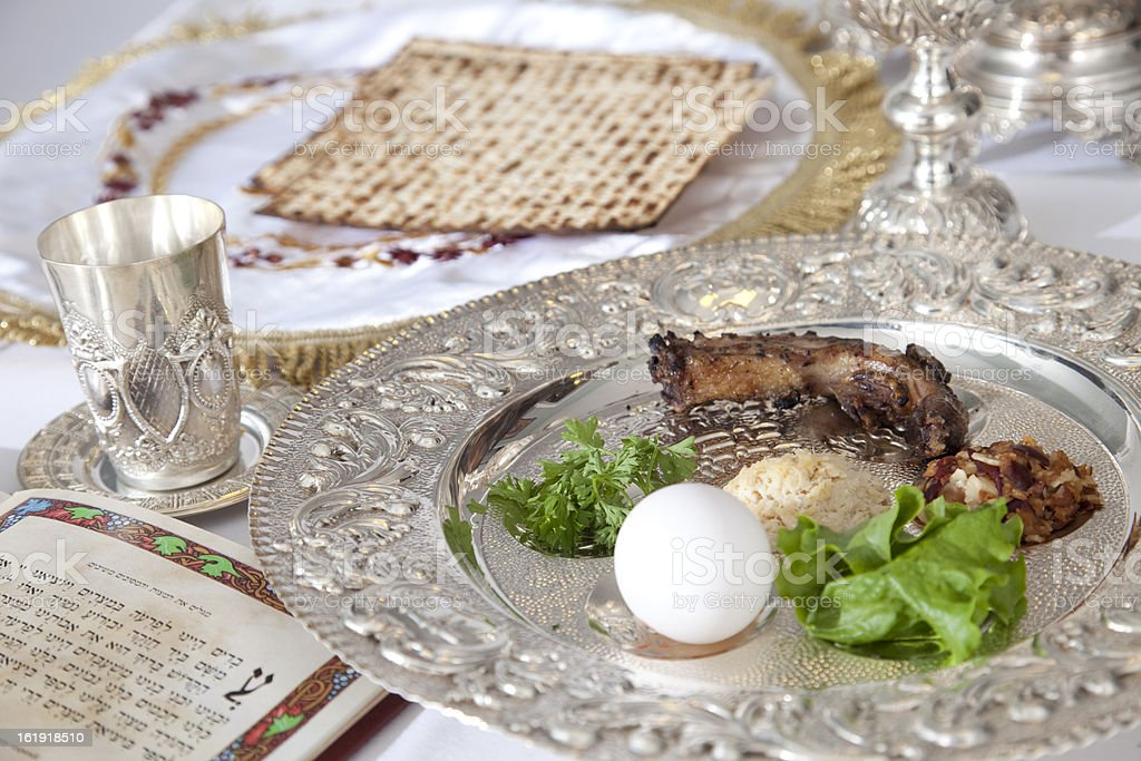 Passover food on silver plate on table stock photo