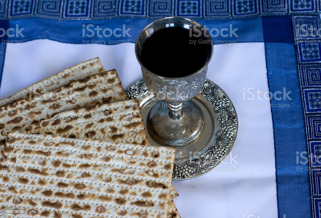 Passover Matzo and Kiddush Cup with wine stock photo