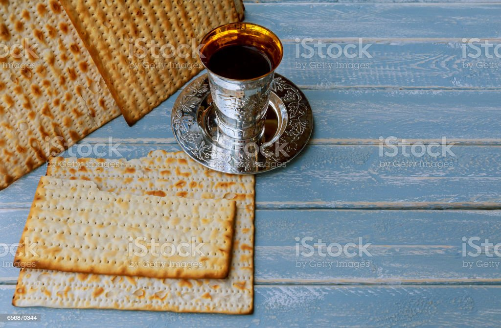 passover matzo with kiddush cup of wine wooden table stock photo