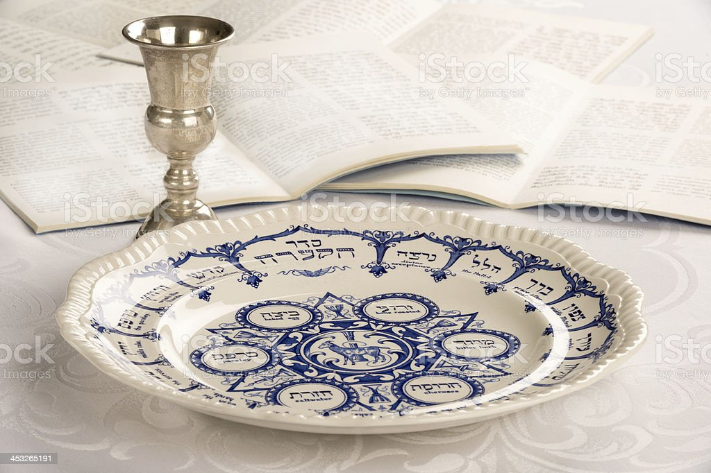 Passover Plate with Kiddush Cup and Haggadah stock photo