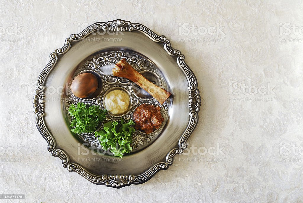Passover seeder plate seen from above on light background stock photo