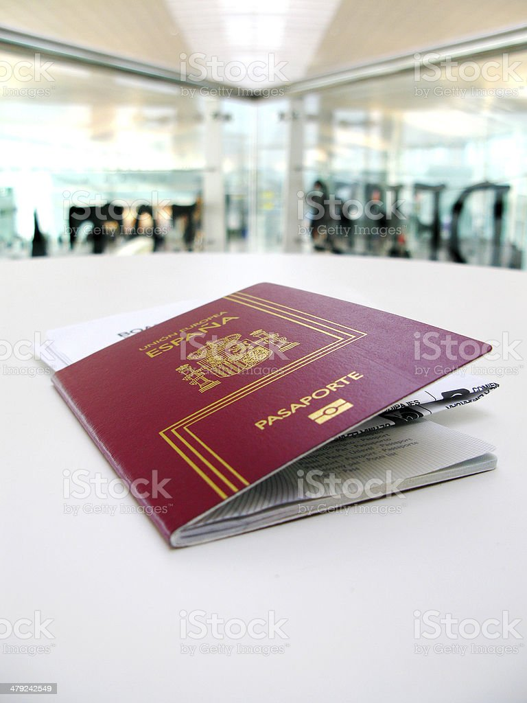 Passport and boarding pass, waiting in a modern airport stock photo