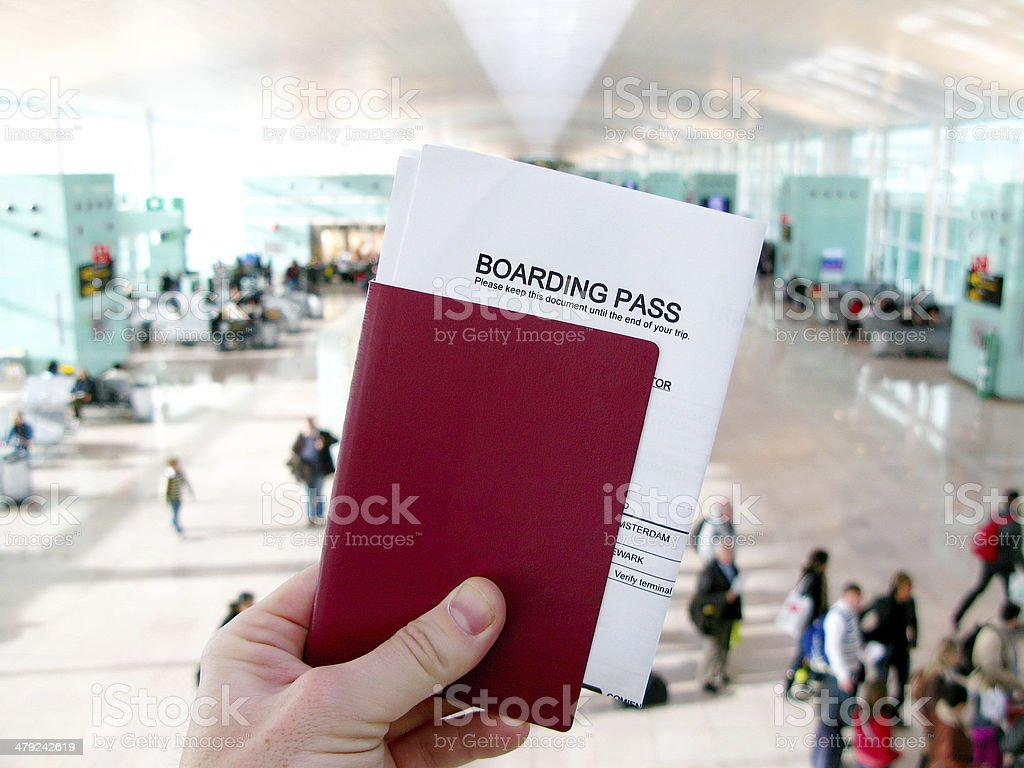 Passport and boarding pass, waiting in a modern airport royalty-free stock photo