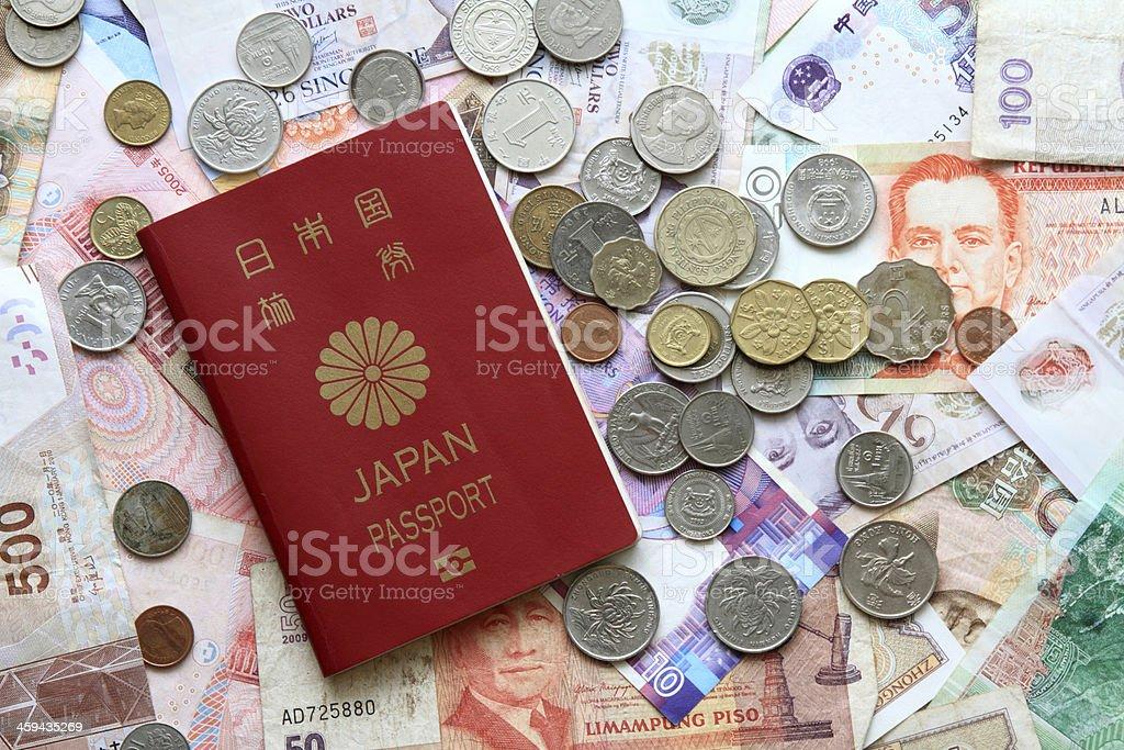 Passport, bills and coins stock photo