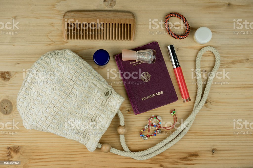 Passport book with beauty items stock photo