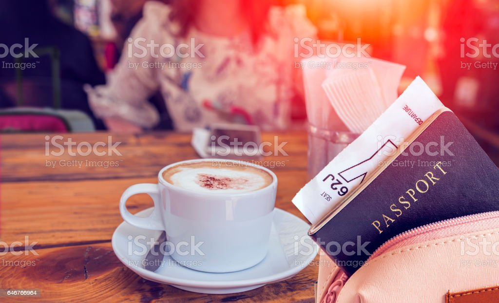 passport in the bag on wooden table stock photo