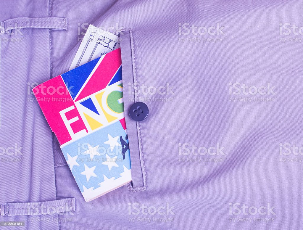 Passport, money, translator in the pocket stock photo