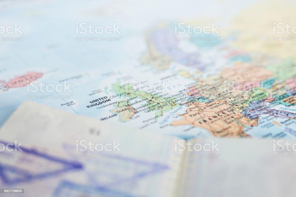 Passport on Earth Map stock photo
