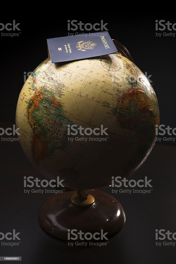 US Passport on top of World Globe royalty-free stock photo