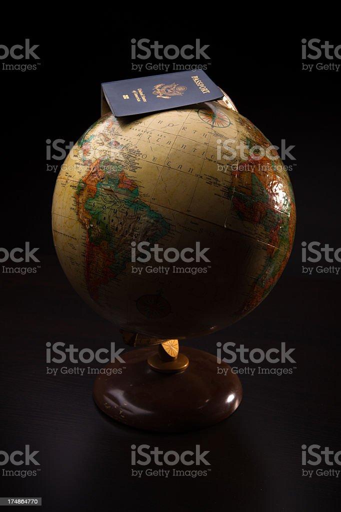 US Passport on World Globe royalty-free stock photo
