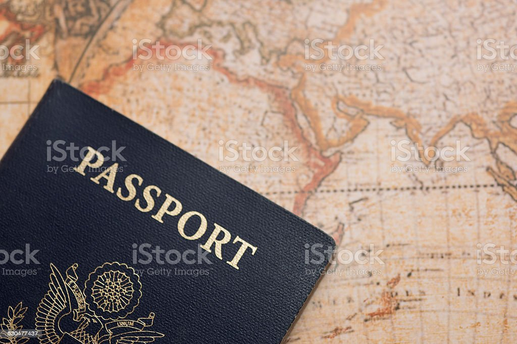 USA Passport on World Map with Copy Space stock photo