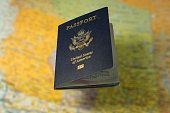USA passport over a blurred map of Canada copy space