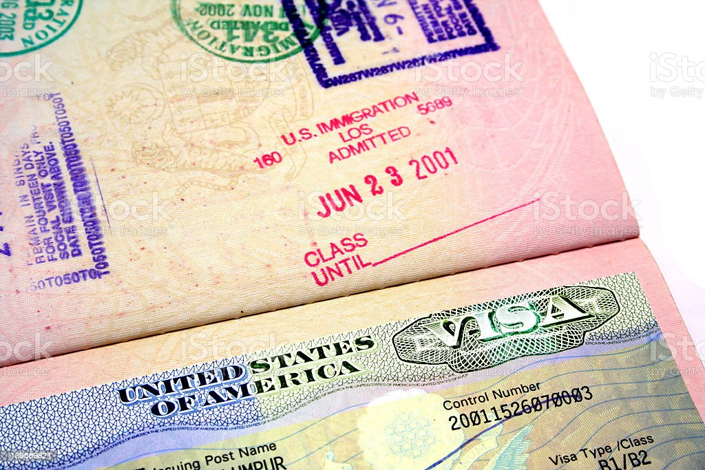 Passport showing US visa and immigration stamp stock photo