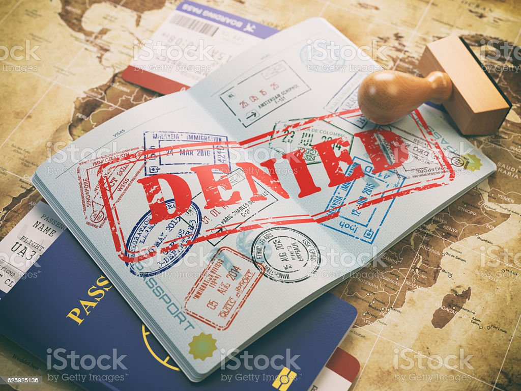 Passport with denied visa stamp on map of the world stock photo